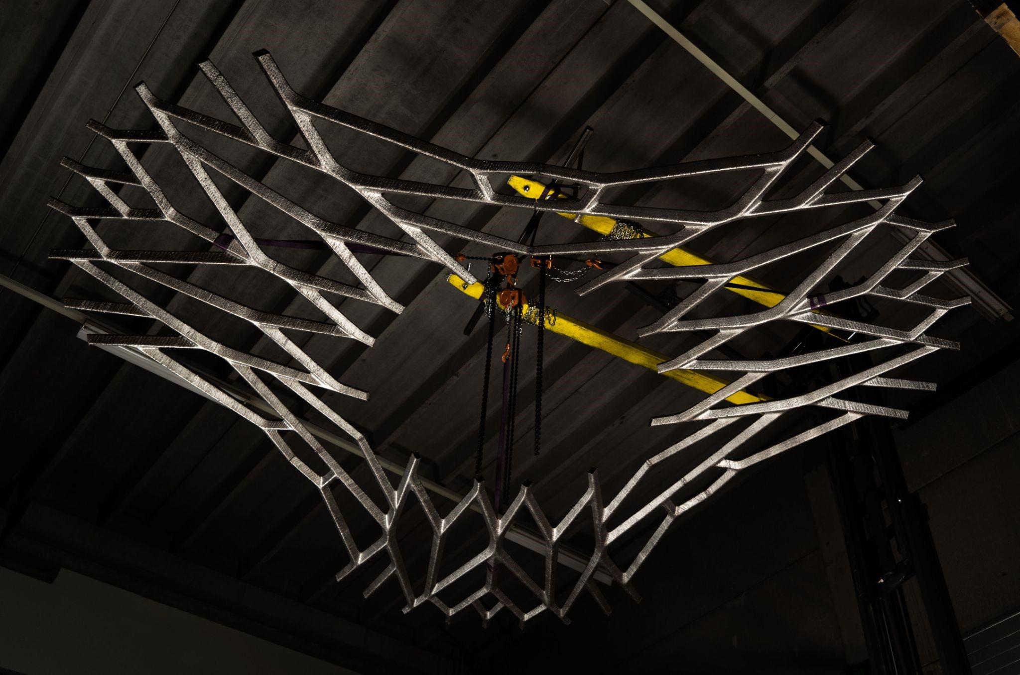Un modello 3D che mostra il design simile al web del pavimento lunare stampato in 3D di MX3D.